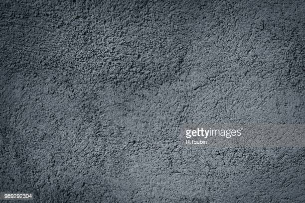 gray plaster wall background textured - old parchment background burnt stock photos and pictures