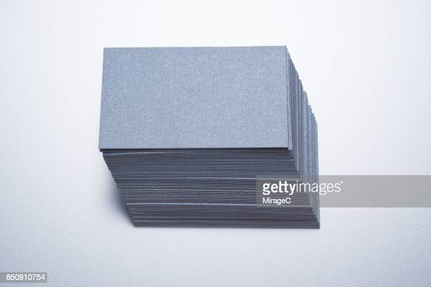 gray silver colored paper cards stacking - 名刺 ストックフォトと画像