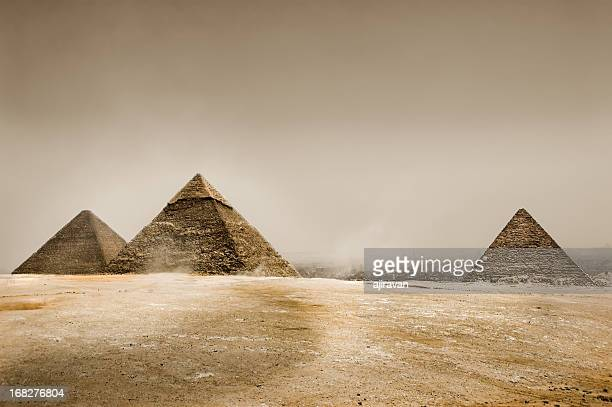 gray sky in the desert with three pyramids - pyramid of chephren stock pictures, royalty-free photos & images