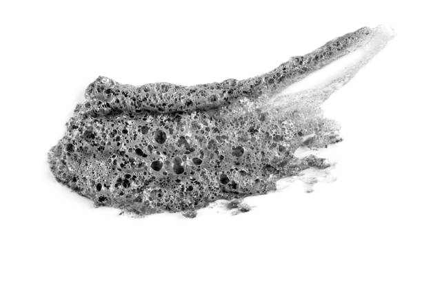 Gray smear of Korean bubble mask on white background isolated. Acne treatment, cosmetology, dermatology. Beauty product. Black clay smudged. Skin care, organic cosmetics. Carbonic acid. Closeup.