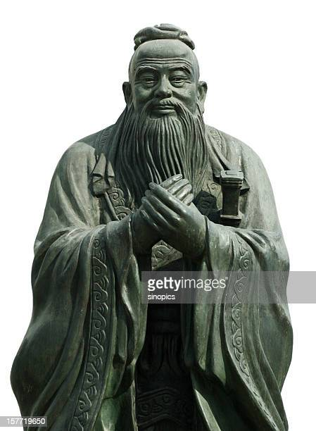 Gray statue of Confucious holding his hands together
