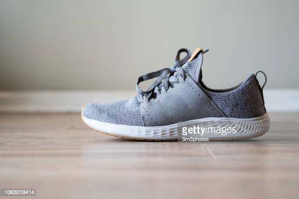 gray tennis shoe running exercise sneaker copy space - gray shoe stock pictures, royalty-free photos & images