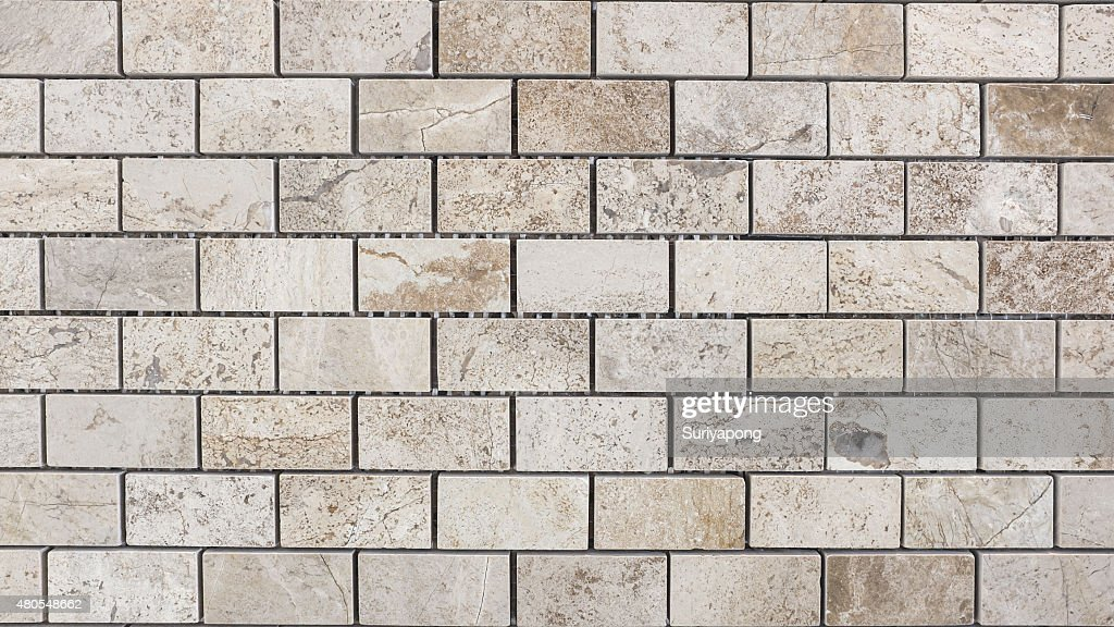 Cinzento mosaico na parede de textura e de backgroud. : Foto de stock