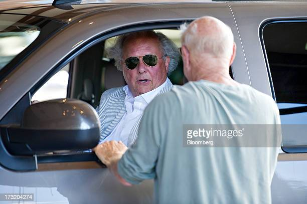 Graydon Carter editor of Vanity Fair talks to Barry Diller chairman of IAC/InterActiveCorp on arrival at the Allen Co Media and Technology Conference...