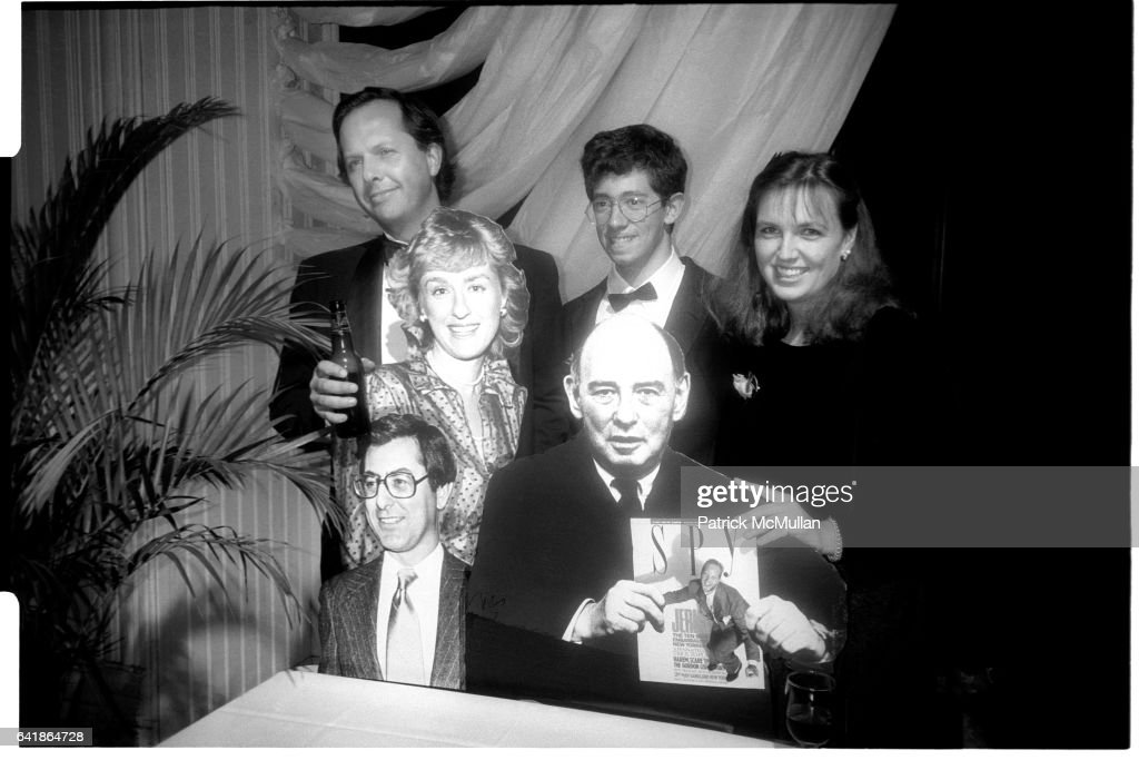 Graydon Carter, Eric Kaplan, and Susan Morrison behind cardboard cut outs of Tina Brown, Ed Kosner (Editor of New York Magazine), and William Shawn (Editor of the New Yorker) holding an issue of SPY magazine at the Spy magazine party at the Puck Building : News Photo