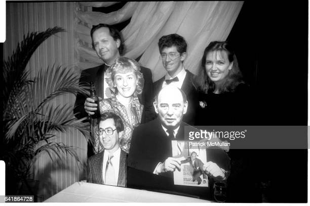 Graydon Carter Eric Kaplan and Susan Morrison behind cardboard cut outs of Tina Brown Ed Kosner and William Shawn holding an issue of SPY magazine at...