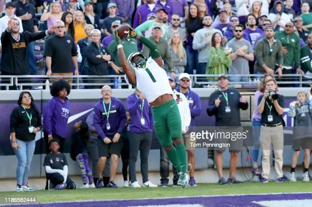Grayland Arnold of the Baylor Bears intercepts a pass in the end zone against the TCU Horned Frogs to end the game 29-23 in triple overtime at Amon...
