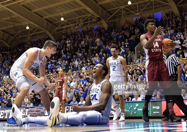 Grayson Allen and Wendell Carter Jr of the Duke Blue Devils react after Carter drew a charging foul against Trent Forrest of the Florida State...