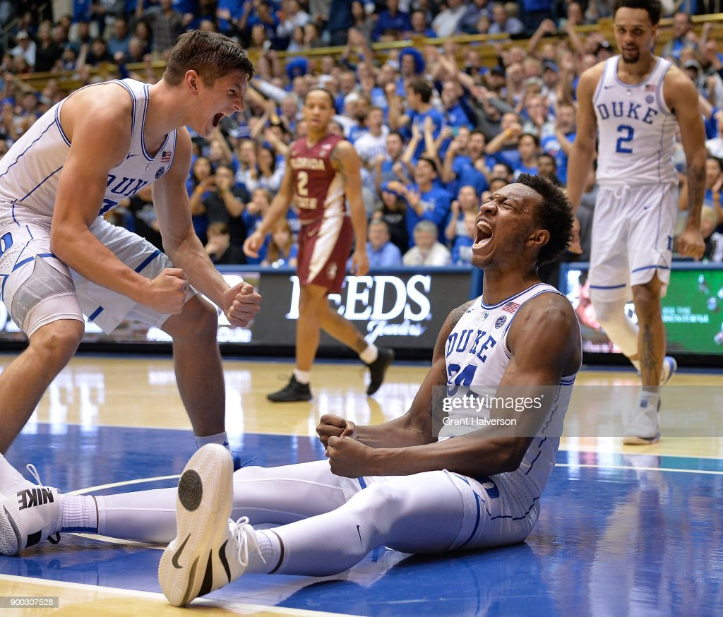 Grayson Allen #3 and Wendell Carter Jr #34 of the Duke Blue Devils react after Carter drew a charging foul against Trent Forrest #3 of the Florida State Seminoles during the closing seconds of their game at Cameron Indoor Stadium on December 30, 2017 in Durham, North Carolina. Duke won 100-93.