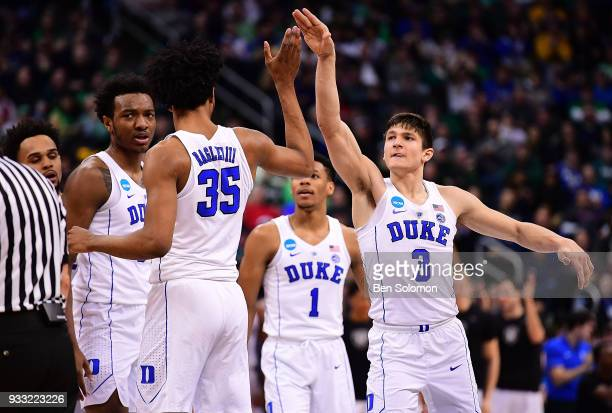 Grayson Allen high fives with Marvin Bagley III of the Duke Blue Devils in the first half during the game against the Rhode Island Rams in the second...