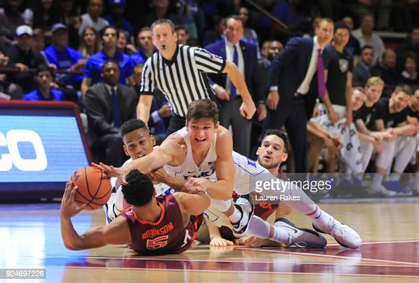 Grayson Allen of the Duke Blue Devils and Justin Robinson of the Virginia Tech Hokies scramble for the ball in the first half at Cassell Coliseum on...