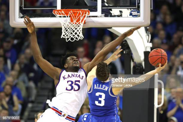 Grayson Allen of the Duke Blue Devils attempts a shot defended by Udoka Azubuike of the Kansas Jayhawks during the second half in the 2018 NCAA Men's...