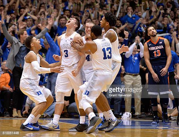 Grayson Allen of the Duke Blue Devils celebrates with teammates after scoring the game-winning basket as time expires during their game against the...