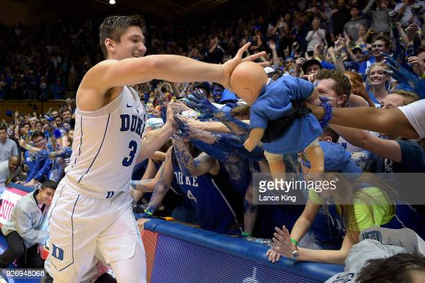 Grayson Allen of the Duke Blue Devils celebrates with the Cameron Crazies following their game against the North Carolina Tar Heels at Cameron Indoor...