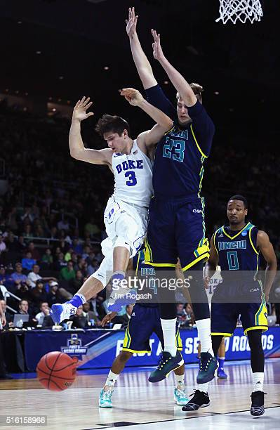 Grayson Allen of the Duke Blue Devils collides with CJ Gettys of the North CarolinaWilmington Seahawks in the first half of their game during the...