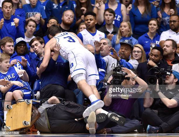Grayson Allen of the Duke Blue Devils crashes into the stands as he dives for a loose ball during their against the Wake Forest Demon Deacons game at...