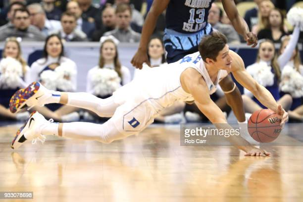 Grayson Allen of the Duke Blue Devils dives to save the ball against the Rhode Island Rams during the first half in the second round of the 2018 NCAA...