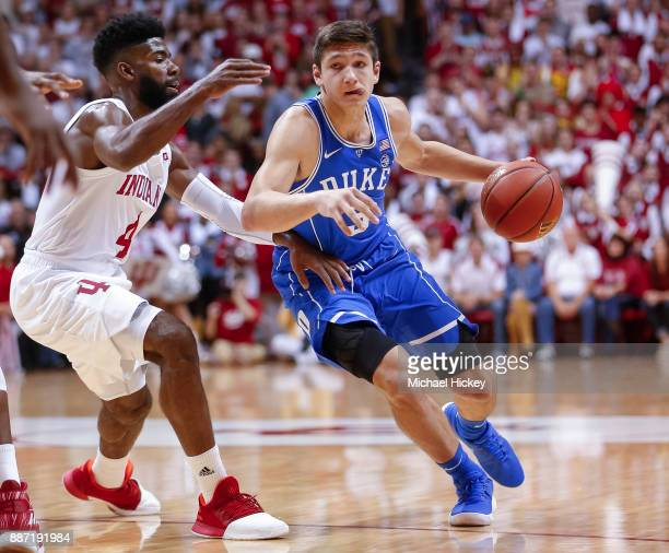 Grayson Allen of the Duke Blue Devils dribbles the ball against Robert Johnson of the Indiana Hoosiers at Assembly Hall on November 29 2017 in...