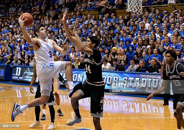 Grayson Allen of the Duke Blue Devils drives against Anas Mahmoud of the Louisville Cardinals during their game at Cameron Indoor Stadium on February...