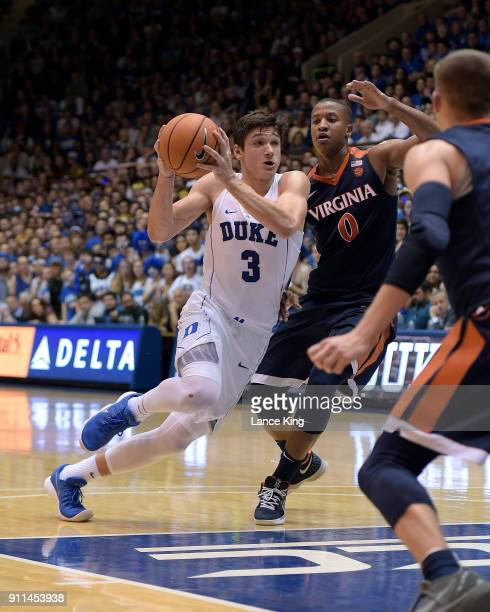 Grayson Allen of the Duke Blue Devils drives against Devon Hall of the Virginia Cavaliers at Cameron Indoor Stadium on January 27 2018 in Durham...