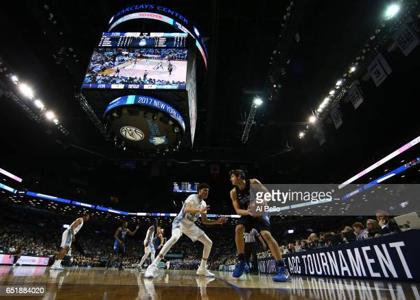 Grayson Allen of the Duke Blue Devils drives against Justin Jackson of the North Carolina Tar Heels during the Semi Finals of the ACC Basketball...