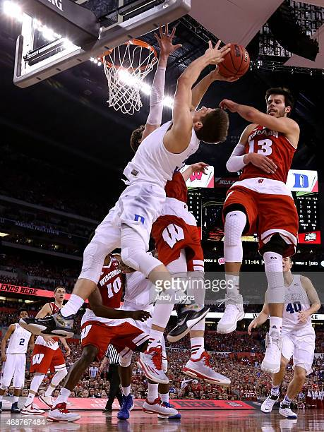Grayson Allen of the Duke Blue Devils drives to the basket against Frank Kaminsky and Duje Dukan of the Wisconsin Badgers in the second half during...