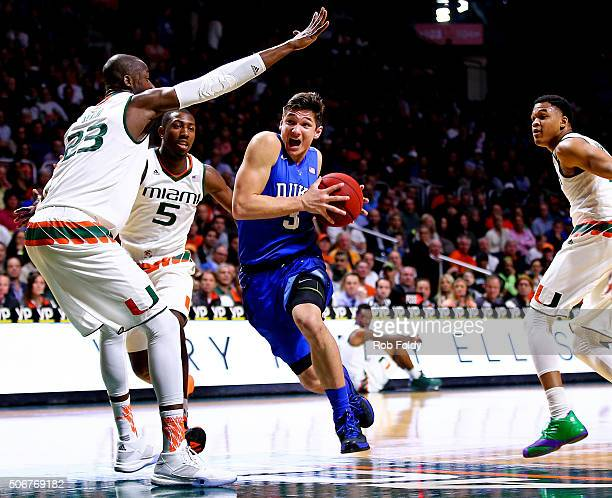 Grayson Allen of the Duke Blue Devils drvies to the basket against Tonye Jekiri of the Miami Hurricanes of the game at the BankUnited Center on...
