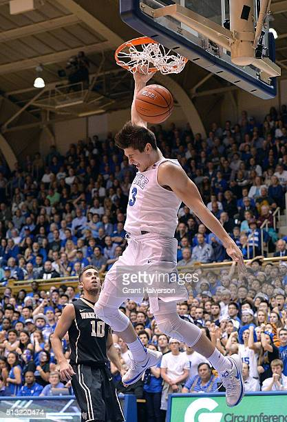 Grayson Allen of the Duke Blue Devils dunks against Mitchell Wilbekin of the Wake Forest Demon Deacons during their game at Cameron Indoor Stadium on...