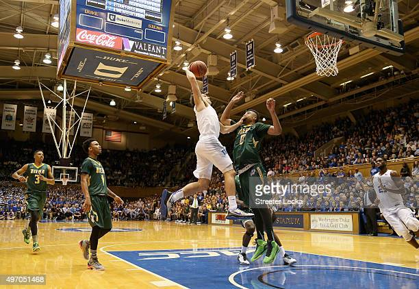 Grayson Allen of the Duke Blue Devils dunks over Javion Ogunyemi of the Siena Saints during their game at Cameron Indoor Stadium on November 13, 2015...