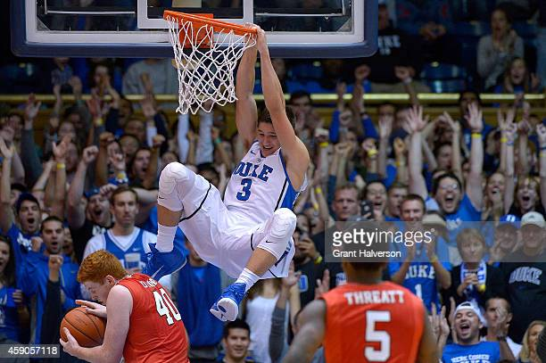 Grayson Allen of the Duke Blue Devils dunks over Kevin Degnan of the Fairfield Stags during their game at Cameron Indoor Stadium on November 15, 2014...
