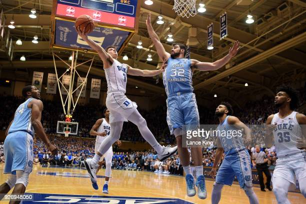 Grayson Allen of the Duke Blue Devils goes to the basket against Luke Maye of the North Carolina Tar Heels at Cameron Indoor Stadium on March 3 2018...