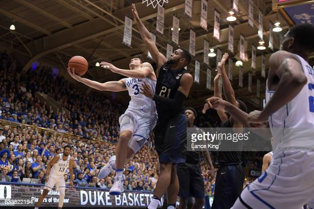 Grayson Allen of the Duke Blue Devils goes to the basket against Sheldon Jeter of the Pittsburgh Panthers at Cameron Indoor Stadium on February 4...