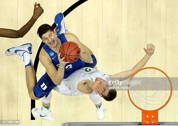 Grayson Allen of the Duke Blue Devils goes up for a shot against Casey Benson of the Oregon Ducks in the second half in the 2016 NCAA Men's...