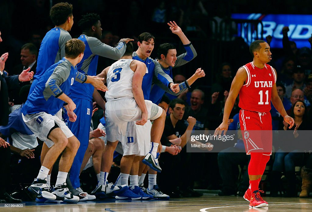 Grayson Allen #3 of the Duke Blue Devils is mobbed by his teammaes after hitting a three-pointer as Brandon Taylor #11 of the Utah Utes looks on during the Ameritas Insurance Classic at Madison Square Garden on December 19, 2015 in New York City. Utah Utes defeated the Duke Blue Devils 77-75.