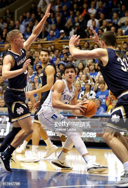 Grayson Allen of the Duke Blue Devils looks to pass around teammates Rex Pflueger and John Mooney of the Notre Dame Fighting Irish during their game...