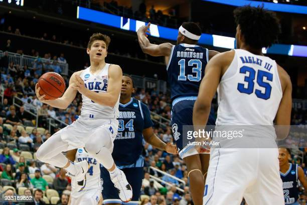 Grayson Allen of the Duke Blue Devils passes the ball to Marvin Bagley III against Stanford Robinson of the Rhode Island Rams during the second half...