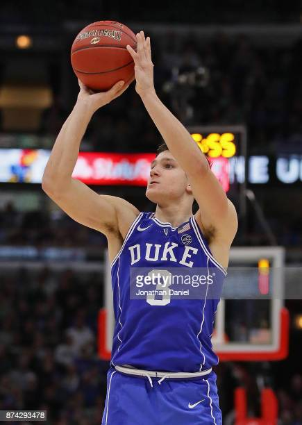 Grayson Allen of the Duke Blue Devils puts up a shot on his way to a game-high 37 points against the Michigan State Spartans during the State Farm...