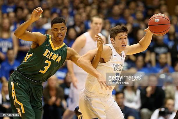 Grayson Allen of the Duke Blue Devils steals the ball from Ryan Oliver of the Siena Saints during their game at Cameron Indoor Stadium on November...