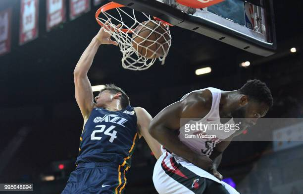 Grayson Allen of the Utah Jazz dunks against Ike Nwamu of the Miami Heat during the 2018 NBA Summer League at the Thomas Mack Center on July 10 2018...