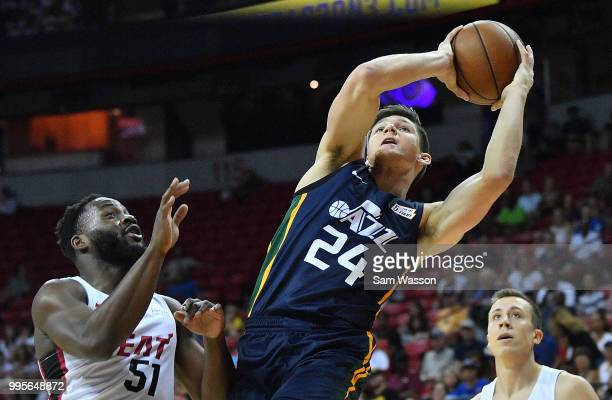 Grayson Allen of the Utah Jazz shoots against Ike Nwamu of the Miami Heat during the 2018 NBA Summer League at the Thomas Mack Center on July 10 2018...
