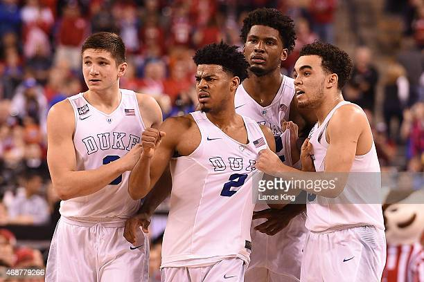 Grayson Allen Quinn Cook Justise Winslow and Tyus Jones of the Duke Blue Devils look toward their bench against the Wisconsin Badgers during the NCAA...