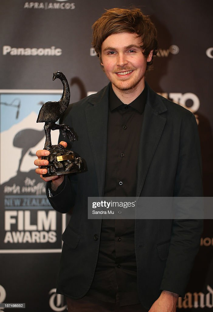 Grayson Gilmour of The Most Fun You Can Have Dying poses with his award for Best Score during the MOA 'Unofficial' New Zealand Film Awards at The Civic on December 4, 2012 in Auckland, New Zealand.