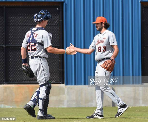 Grayson Greiner and Adam Ravenelle of the Detroit Tigers shake hands during Spring Training workouts at the TigerTown complex on February 15 2017 in...