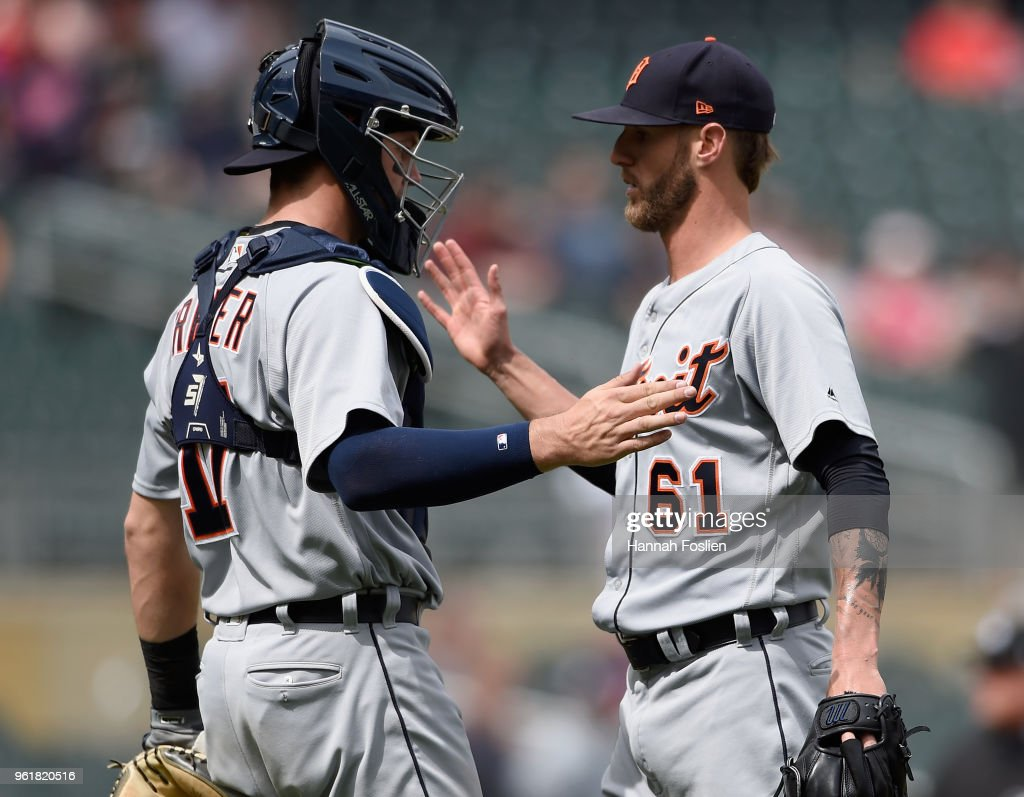 Grayson Greiner #17 and Shane Greene #61 of the Detroit Tigers celebrate defeating the Minnesota Twins 4-1 after the game on May 23, 2018 at Target Field in Minneapolis, Minnesota. The Tigers defeated the Twins 4-1.