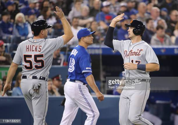 Grayson Greiner of the Detroit Tigers is congratulated by John Hicks after both runners scored on a tworun single by Jeimer Candelario in the seventh...