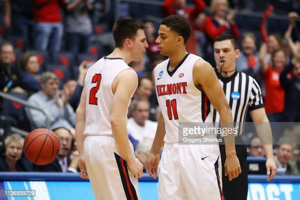 Grayson Murphy celebrates with Kevin McClain of the Belmont Bruins during the second half against the Temple Owls in the First Four of the 2019 NCAA...