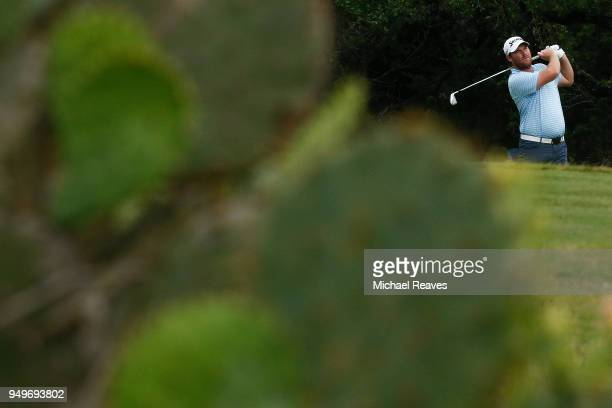 Grayson Murray plays his shot from the seventh tee during the third round of the Valero Texas Open at TPC San Antonio ATT Oaks Course on April 19...