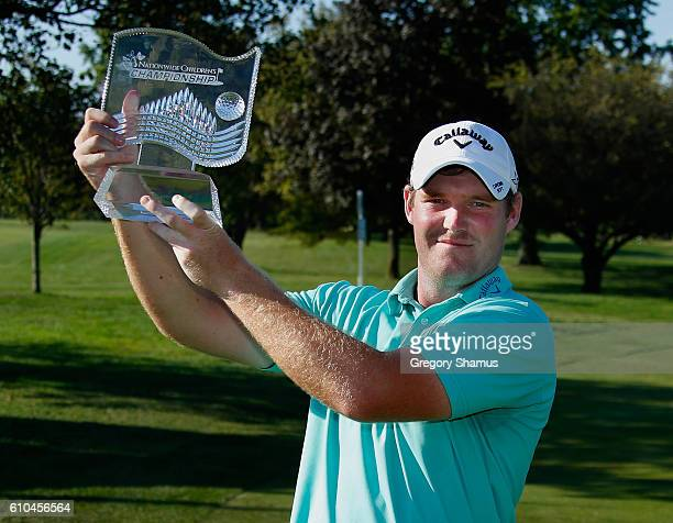 Grayson Murray poses with the championship trophy after winning the Webcom Tour Nationwide Children's Hospital Championship at The Ohio State...