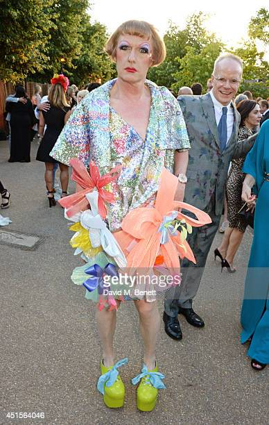 Grayson Perry and HansUlrich Obrist attend The Serpentine Gallery Summer Party cohosted by Brioni at The Serpentine Gallery on July 1 2014 in London...