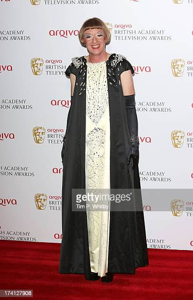 Grayson Perry poses in the press room at the Arqiva British Academy Television Awards 2013 at the Royal Festival Hall on May 12 2013 in London England